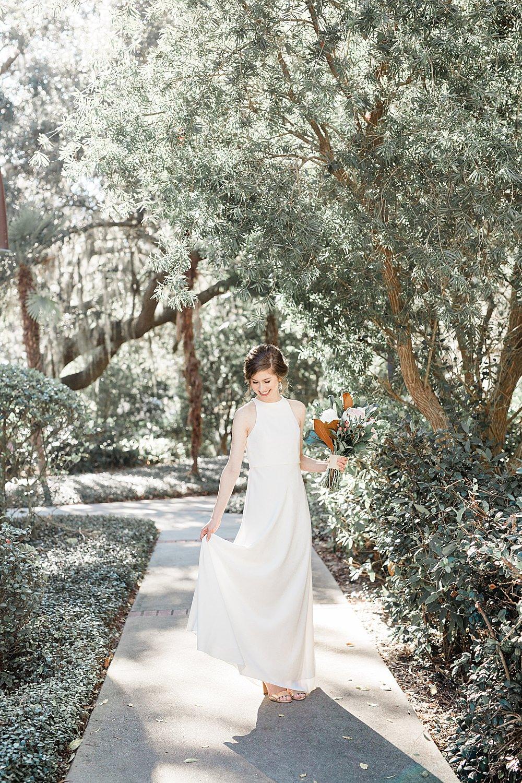 Bride twirls her dress outside of the Baughman Center