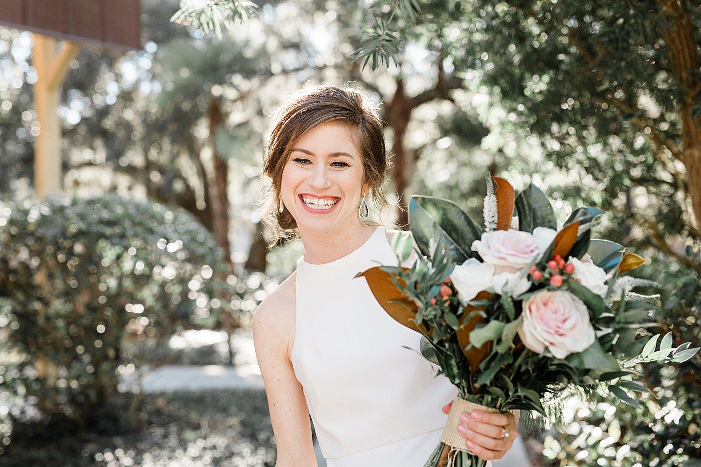 Bride smiles as she walks to her wedding venue