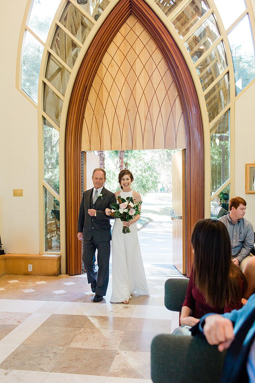 Bride and Father enter through the doors of the Baughman Center