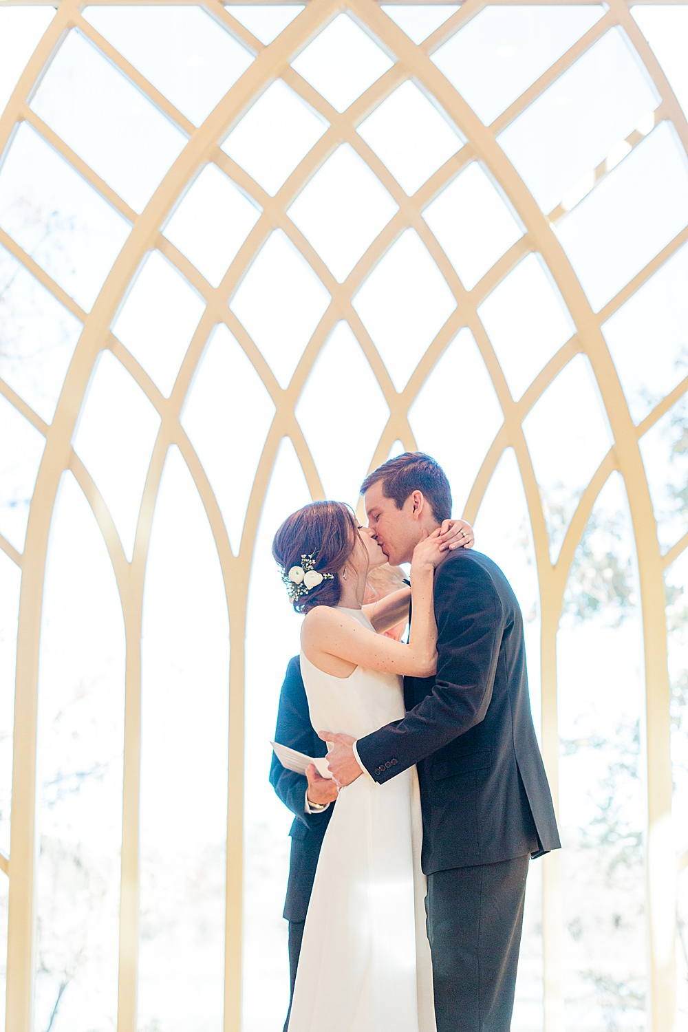 Bride and Groom share first kiss at the Baughman Center