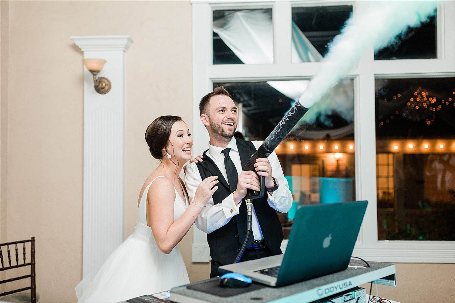 Bride and Groom shoot fog cannon with DJ from White Tie Events