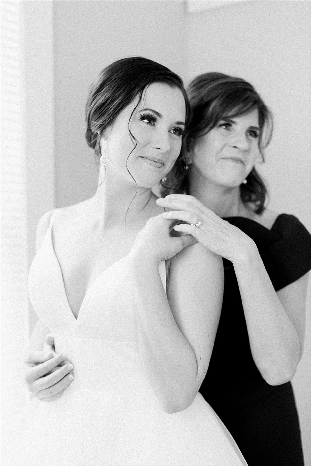 Black and white photo of bride with her mom