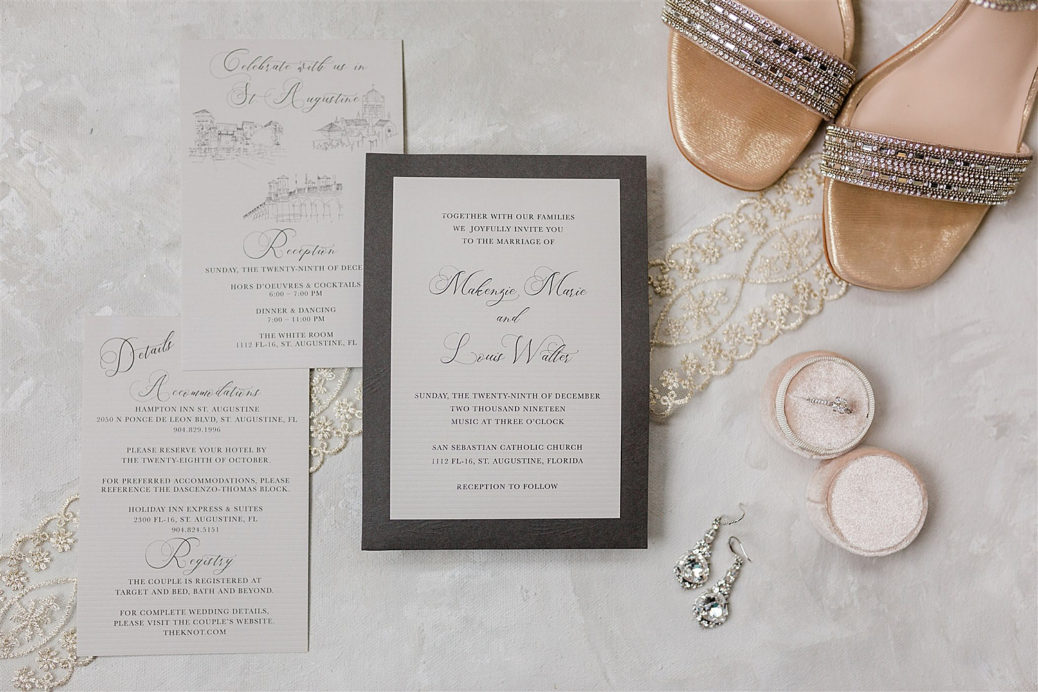 Detail of calligraphy and jewelry with wedding invitation