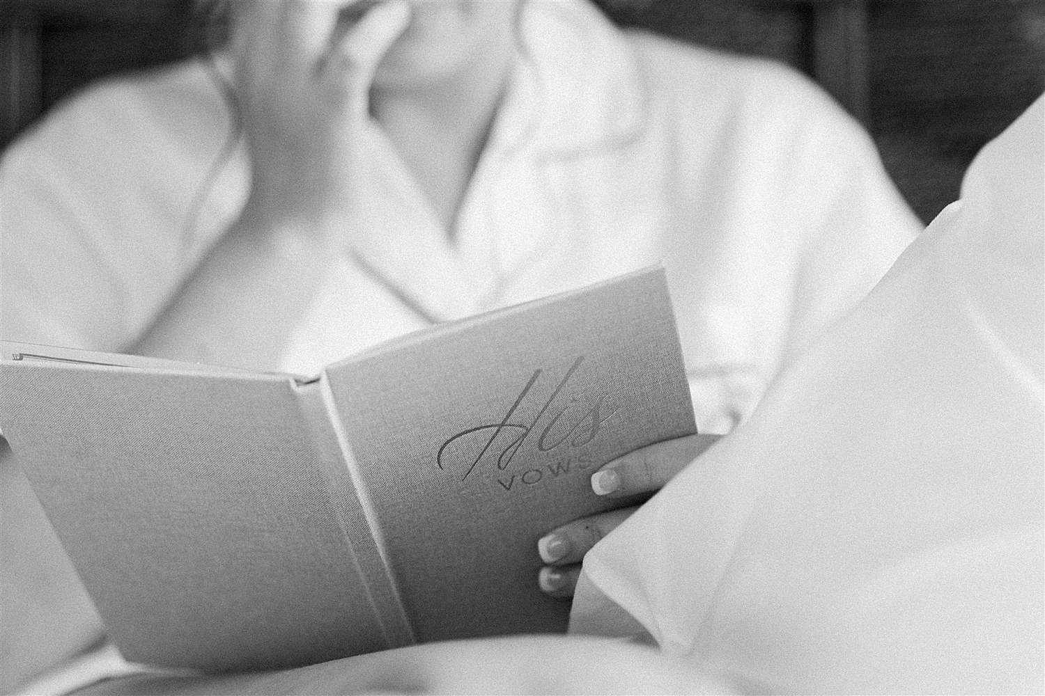 Black and white photo of bride reading letter from groom