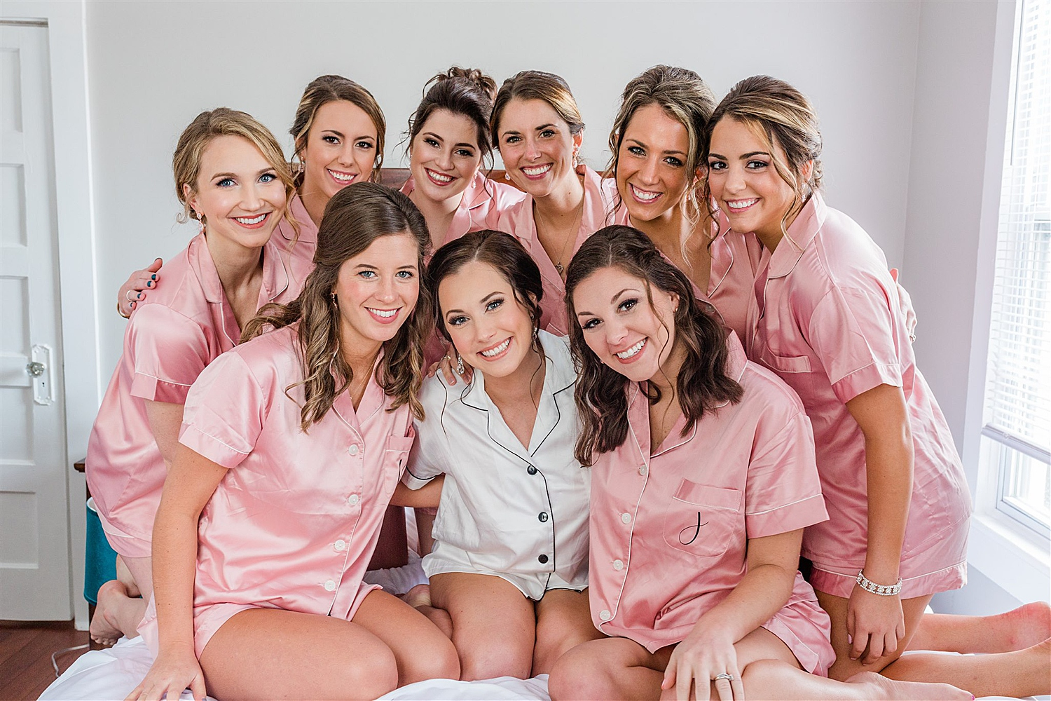 Bride and Bridesmaids smiling in robes