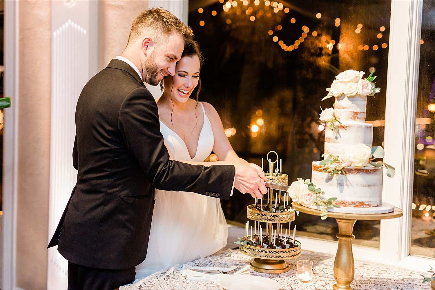 Bride and Groom cut their three tiered naked cake at the white room in st augustine florida