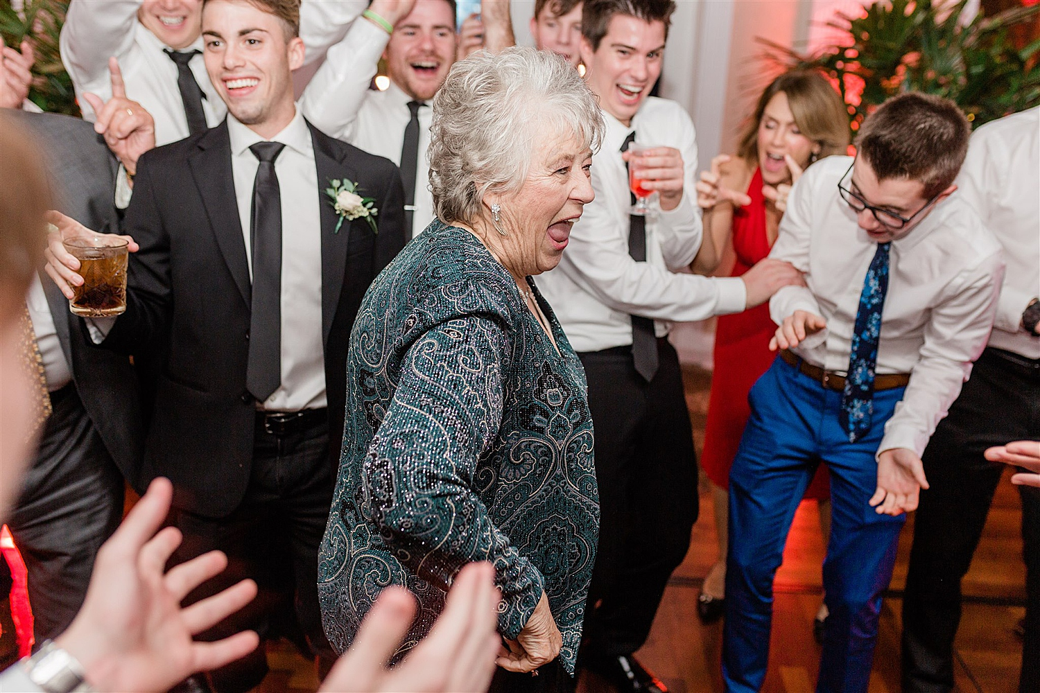 Grandma joins the wedding party on the dance floor