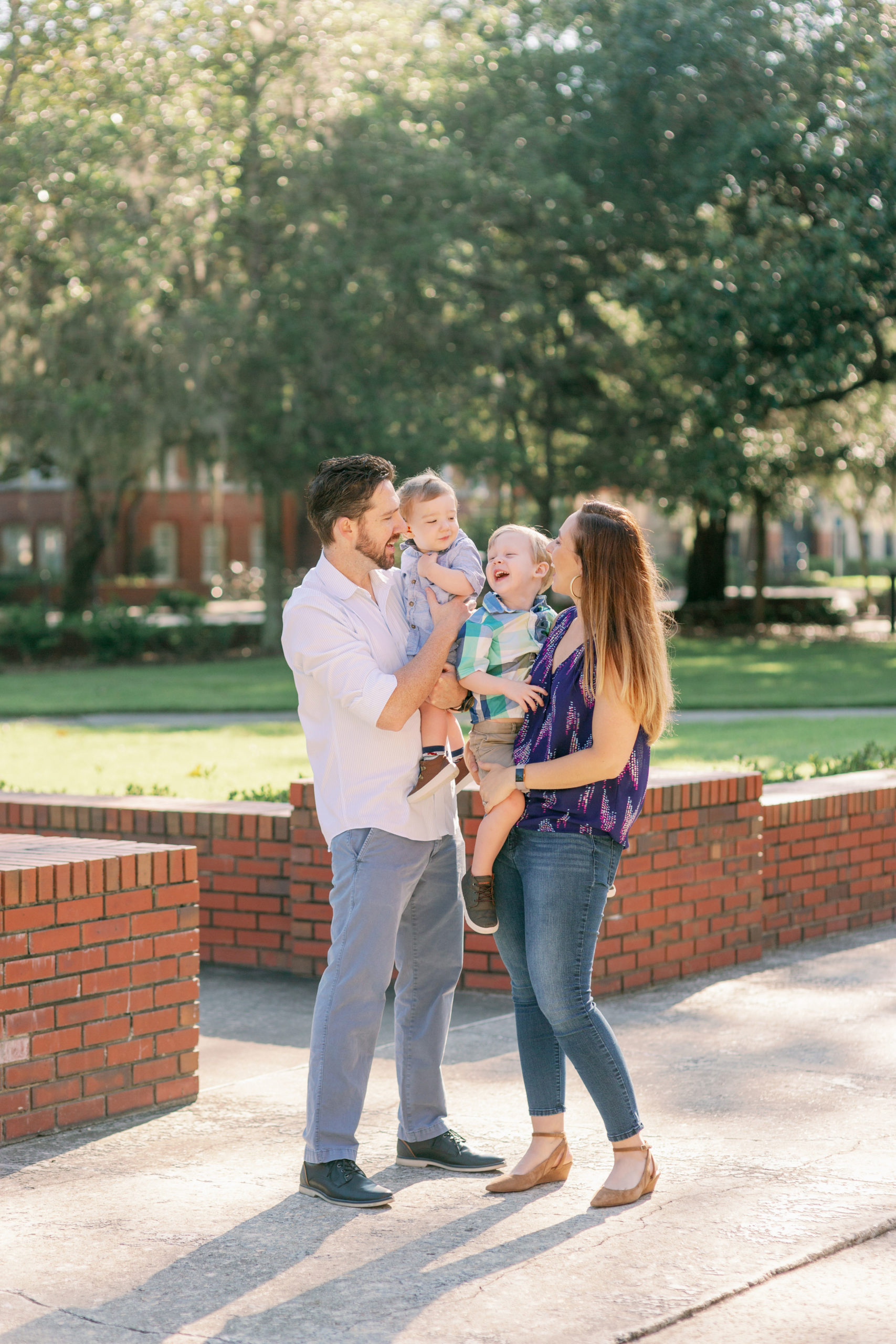 Mom, Dad and Two Sons laugh together at the University of Florida