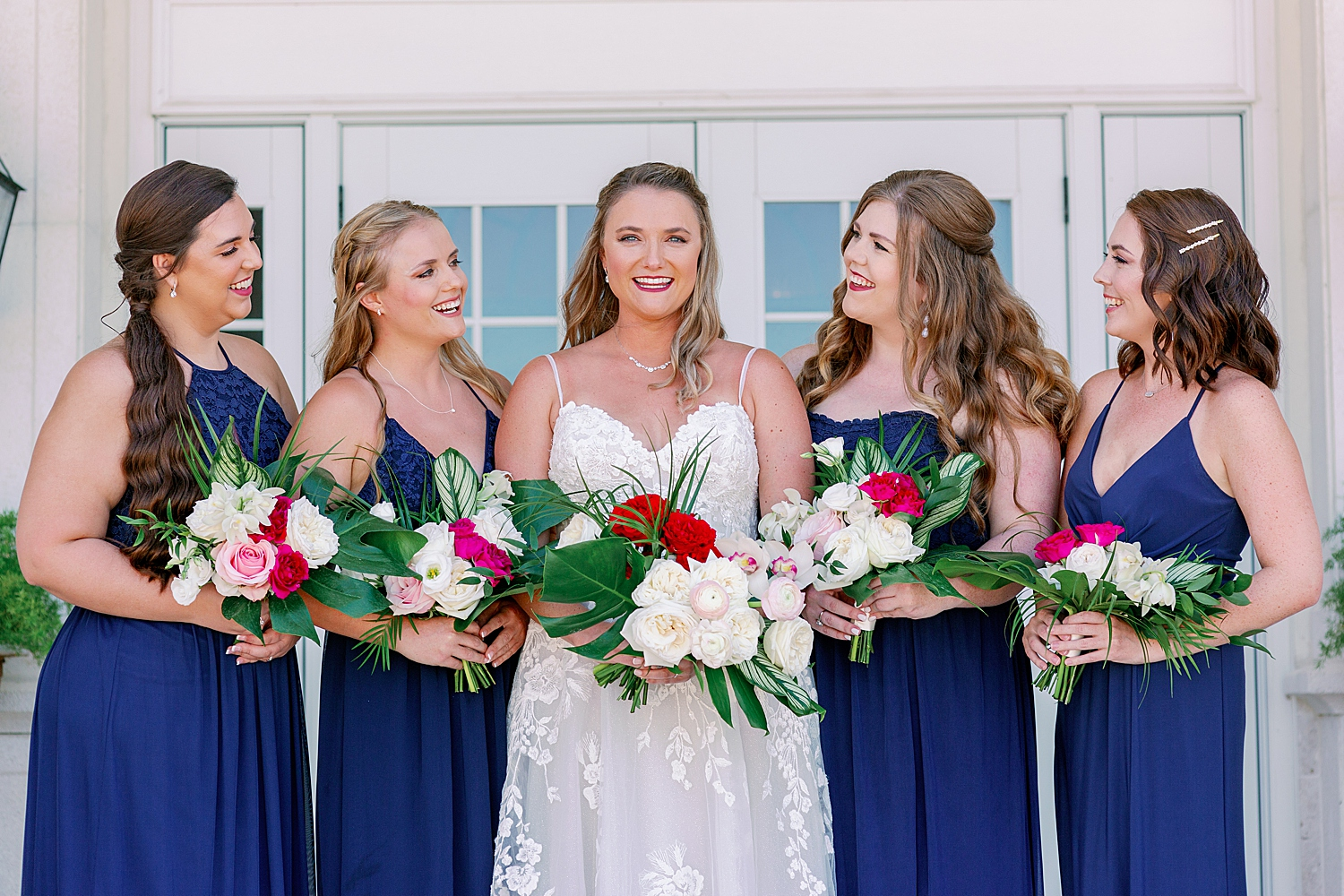 Smiling bride with her bridesmaids