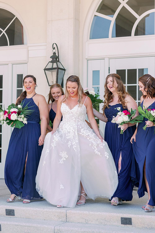 Bride and bridesmaids walking and laughing