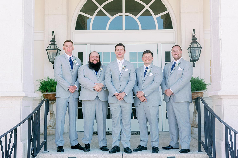 Groom with groomsmen on wedding day