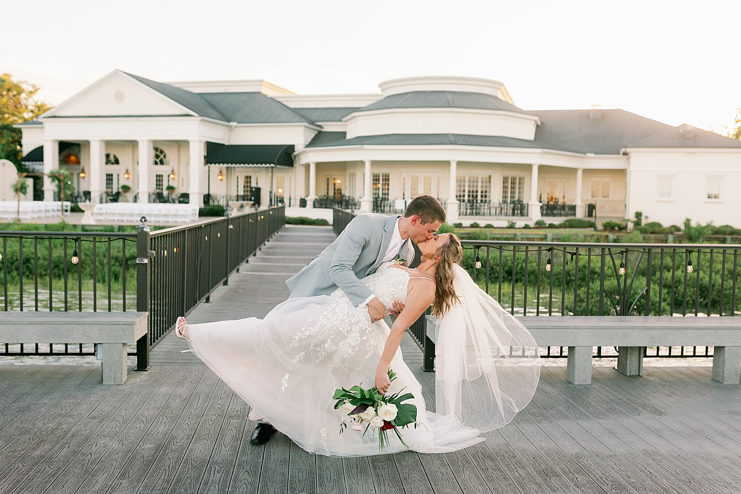 Bride and Groom in dip kiss pose at River House At. Augusitne