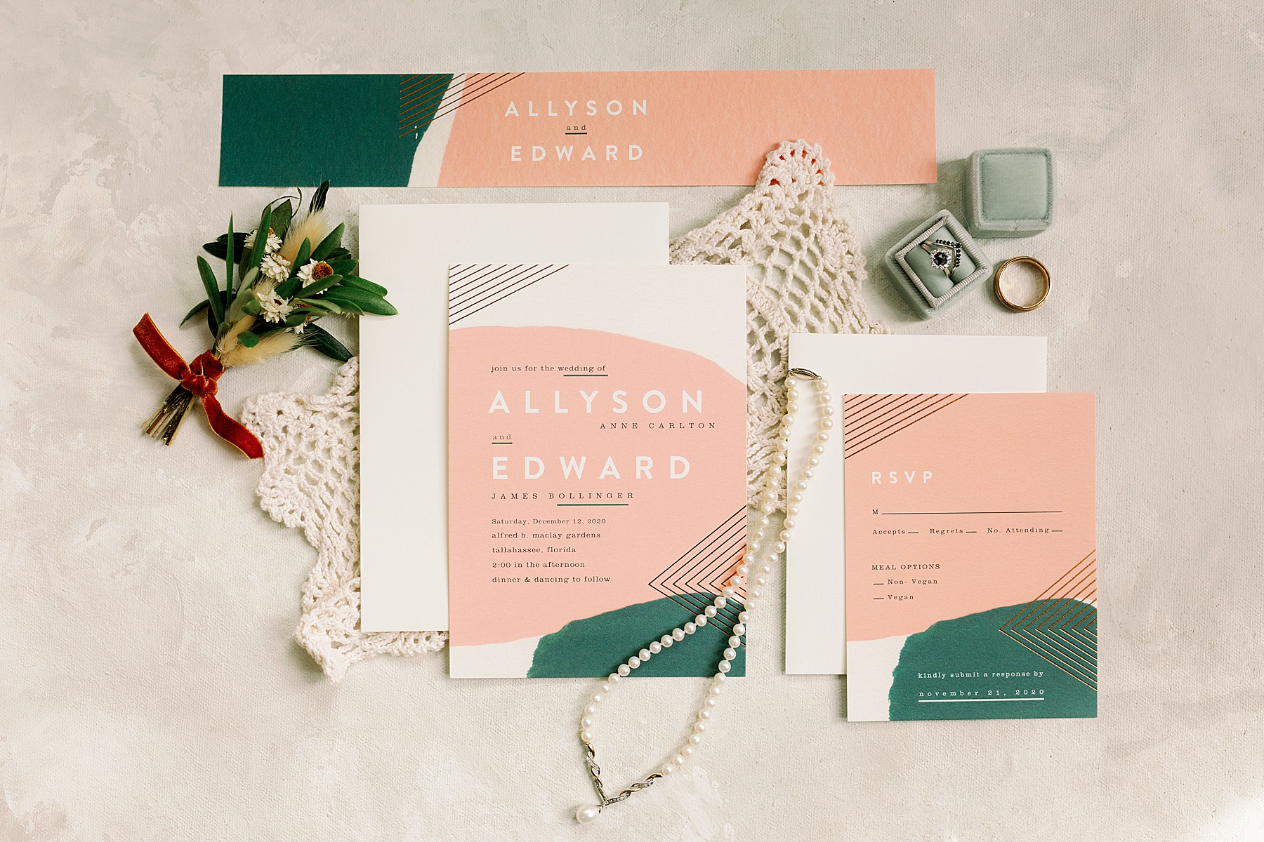 Pink and Green wedding invitation laid out with bridal jewlery