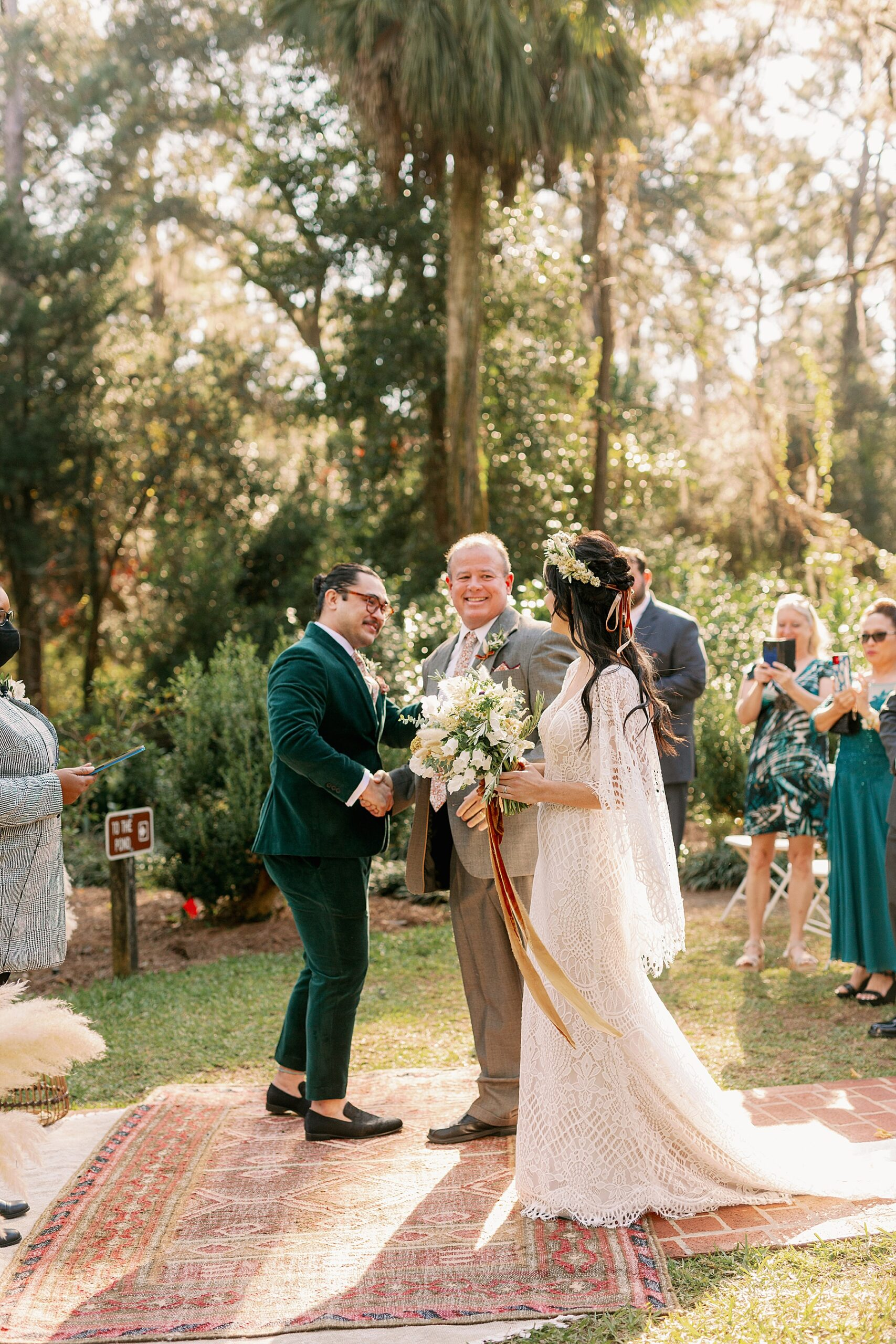 Groom and Bride's dad shake hands at wedding ceremony
