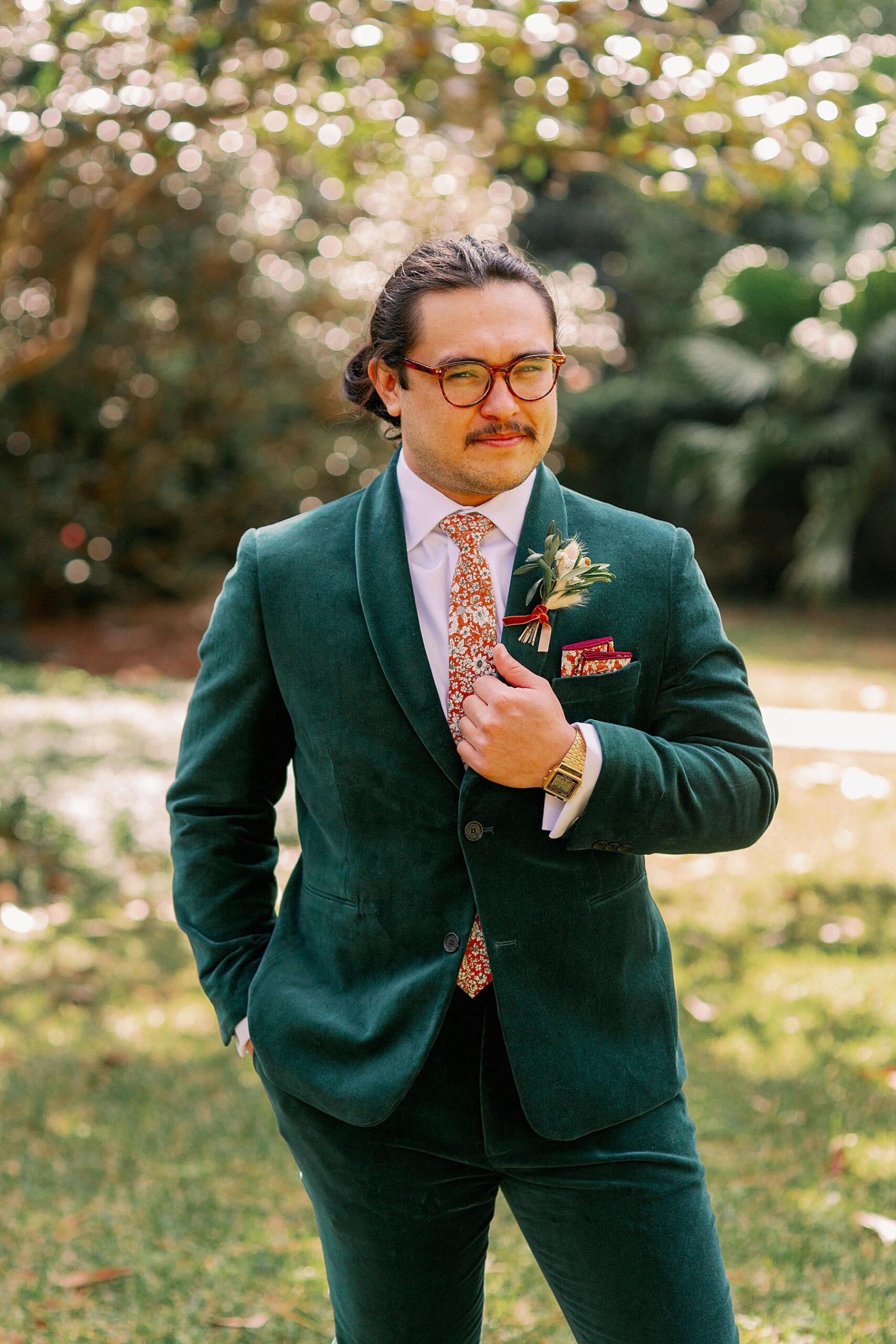 Portrait of Groom in green velvet suit on wedding day