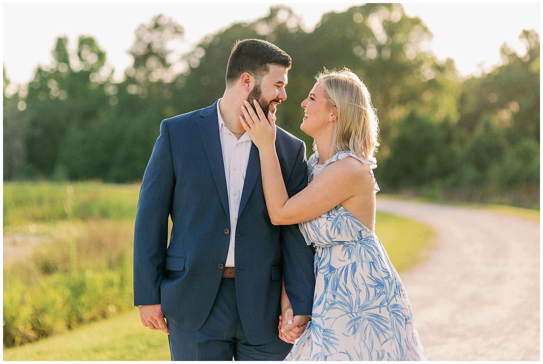 Girl shows off engagement ring in photo with her fiance